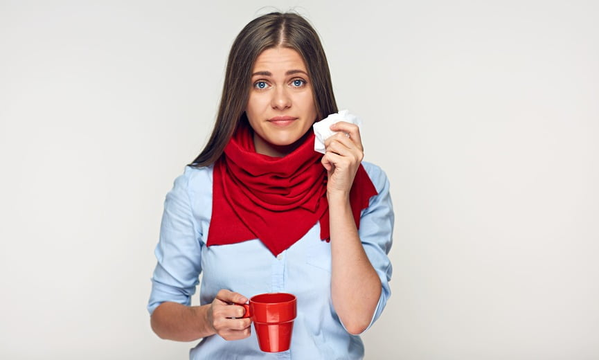 Sickness woman holding red cup and paper tissue