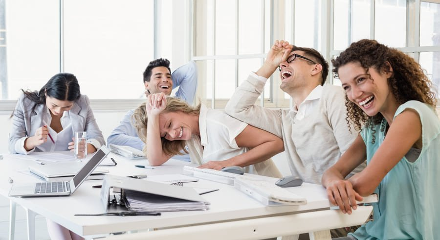Business team laughing during meeting