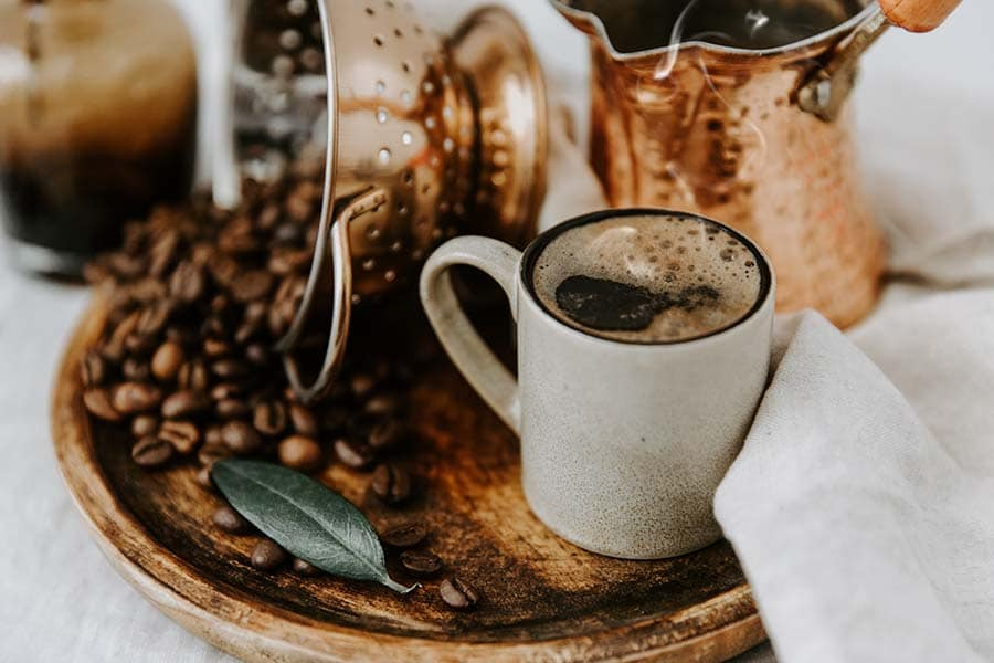 Turkish Coffee Pot and Coffee beens on linen table