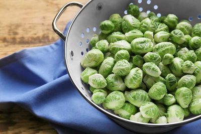 Brussels sprouts in colander on napkin