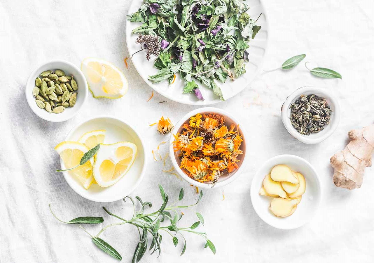 Ingredients for liver detox antioxidant tea on a light background, top view. Dry herbs, roots, flowers for homeopathy recipe for detox drink. Flat lay
